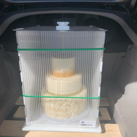How to transport a huge cake.